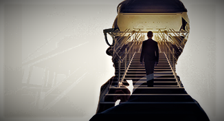 Image of Person walking up the stairs inside a head silhouette
