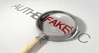 Image of A magnifier on the word fake