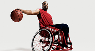 Image of Man in a wheelchair playing basketball